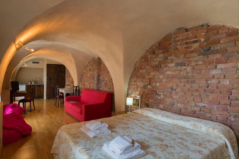 ห้องซูพีเรียสวีท, 1 ห้องนอน, ห้องครัว, วิวสวนหย่อม - ห้องนั่งเล่น