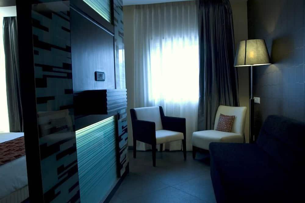 Suite, 1 queensize bed - Woonruimte