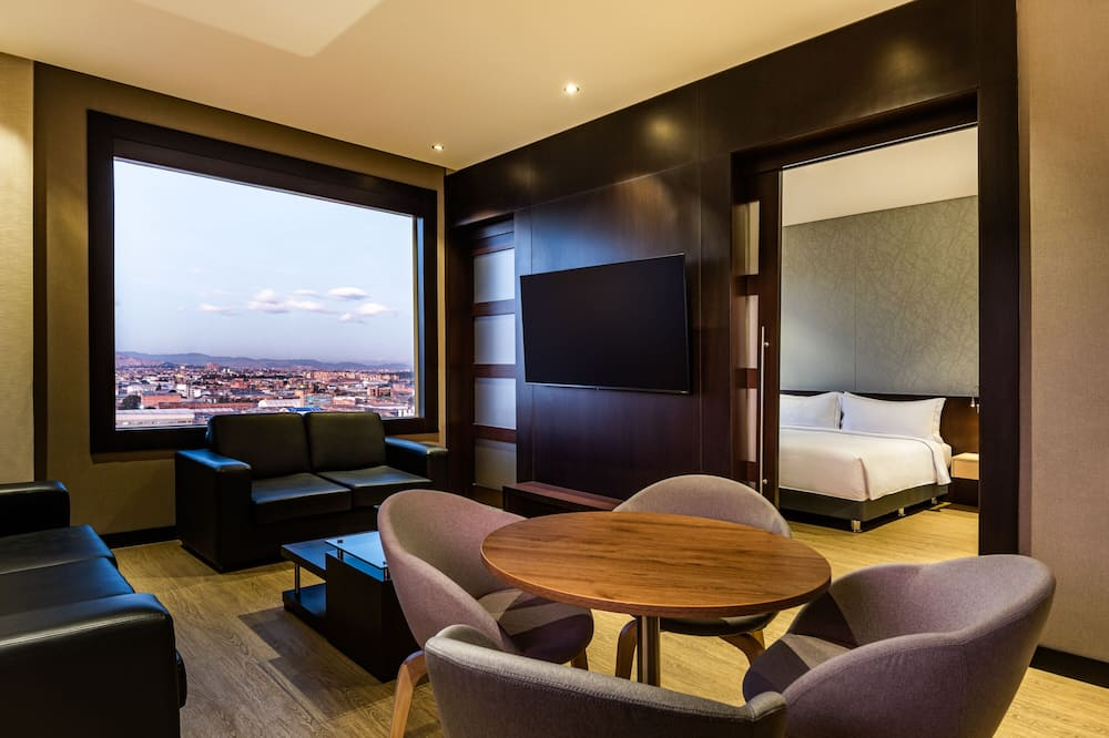Suite, 1 letto king - Area soggiorno