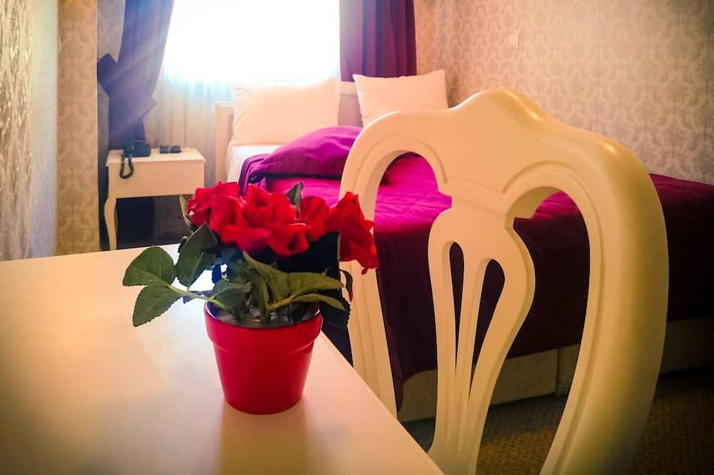 Basic szoba kétszemélyes vagy két külön ággyal, 1 hálószobával - Nappali rész