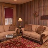Suite – deluxe, 1 queensize-seng, peis, anneks - Oppholdsområde
