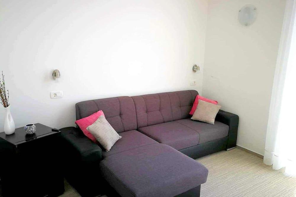 Prémium lakosztály, 1 hálószobával, kilátással a tengerre - Nappali
