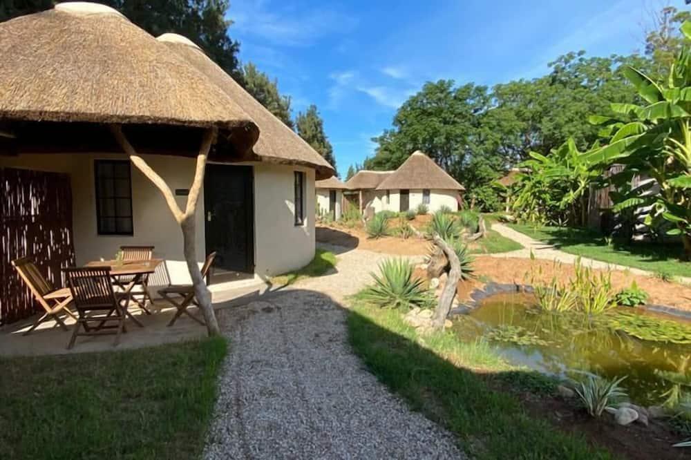 Deluxe kämpingumaja - Vaade aiale