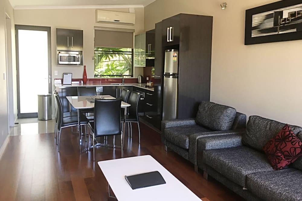 Departamento Deluxe, 2 habitaciones, planta baja (Unit 5) - Sala de estar