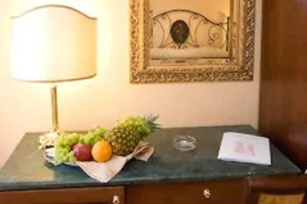 Třílůžkový pokoj - Obývací prostor