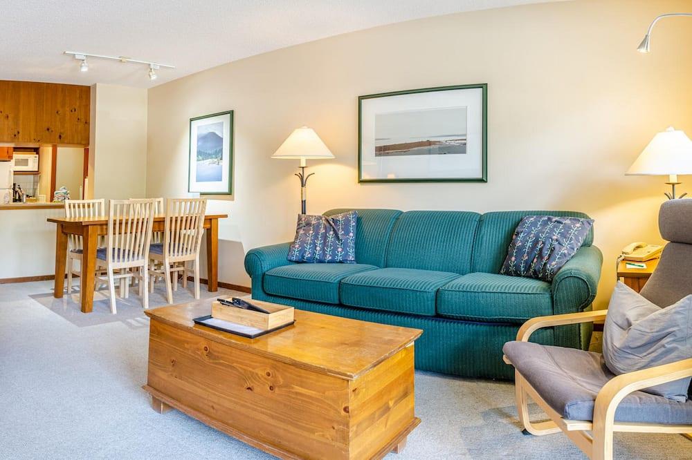 スイート キングベッド 1 台ソファーベッド付き - リビング エリア