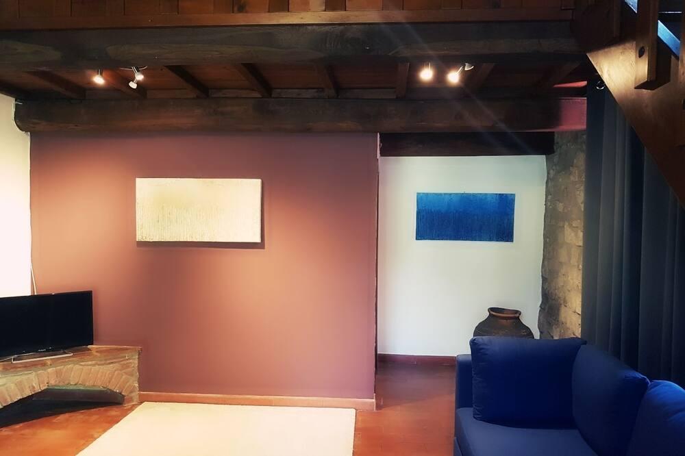 Apartmán typu Deluxe, 1 ložnice, výhled do zahrady (Compiobbi) - Obývací prostor