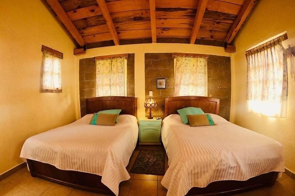 كابينة عائلية - سريران مزدوجان - بمدفأة - منظر للجبل (Ciruelo) - الغرفة