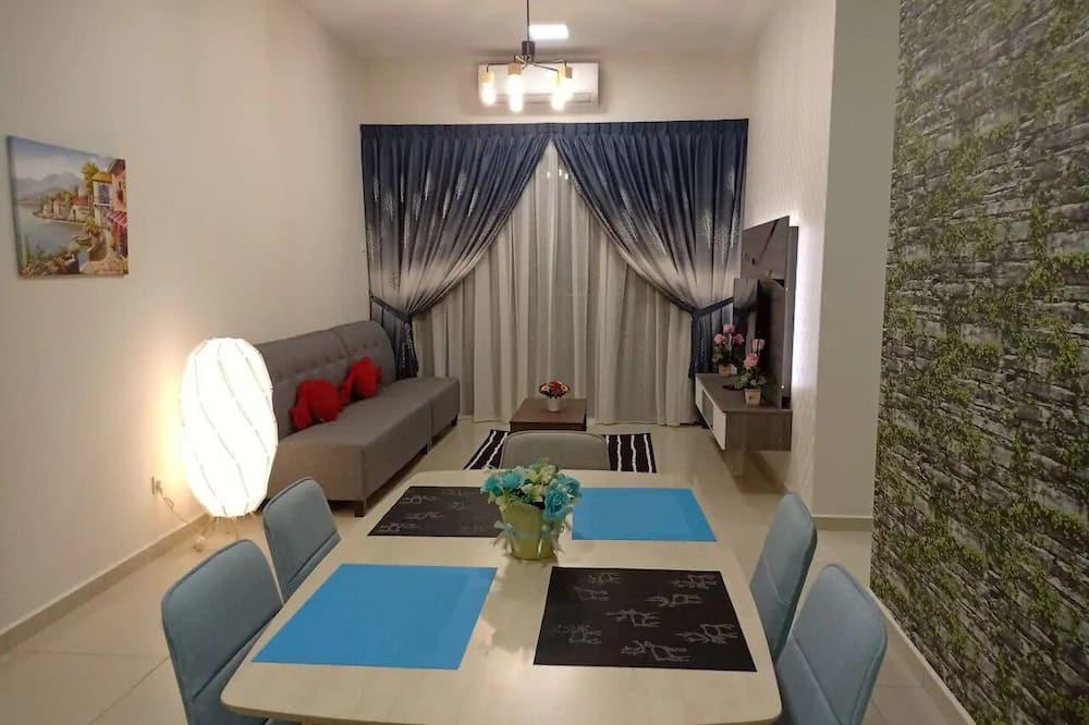 City appartement - Eetruimte in kamer