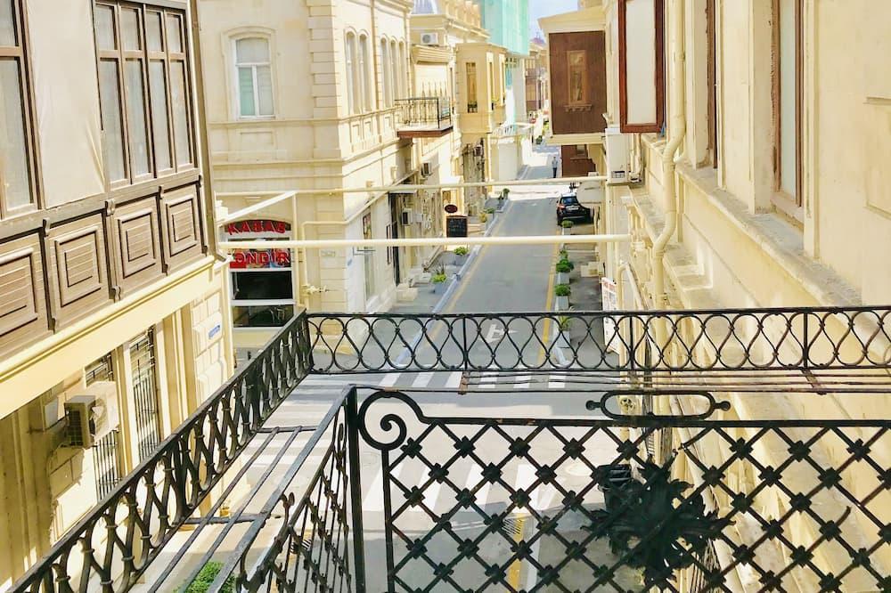 Chambre Familiale, balcon - Vue sur la ville