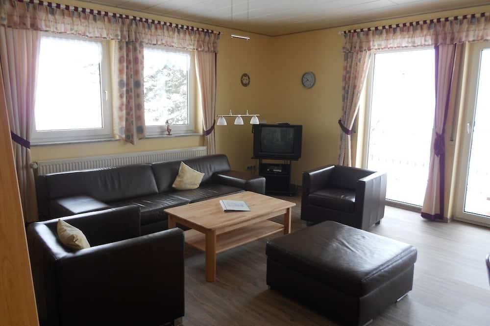 Apartamento (Gestiefelter Kater) - Sala de estar