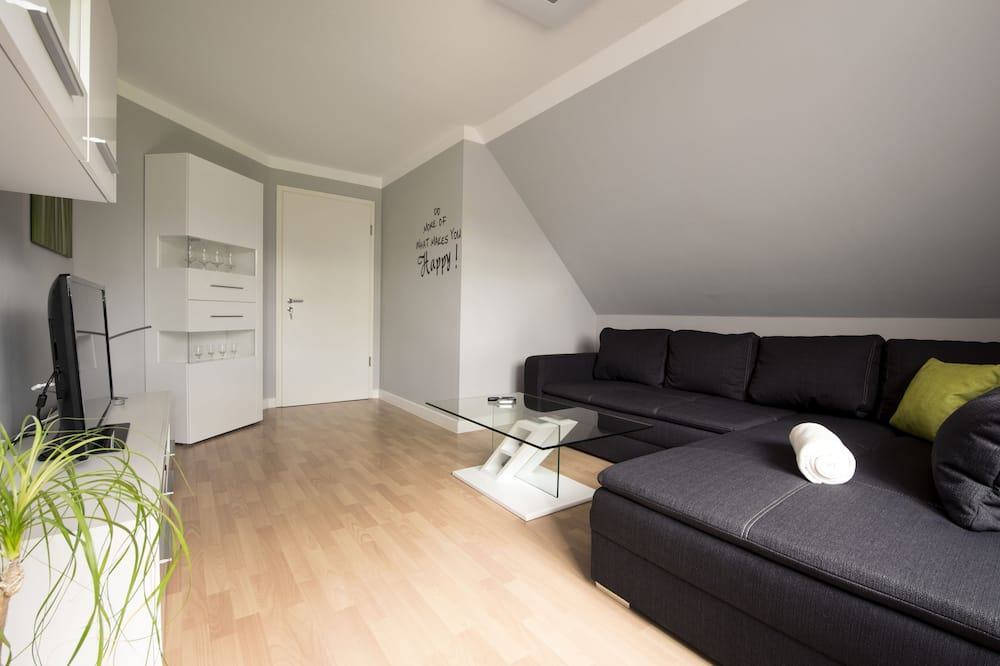 شقة ديلوكس - بشرفة - منطقة المعيشة