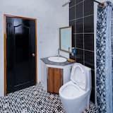 Deluxe Double - Pool View - Badezimmer