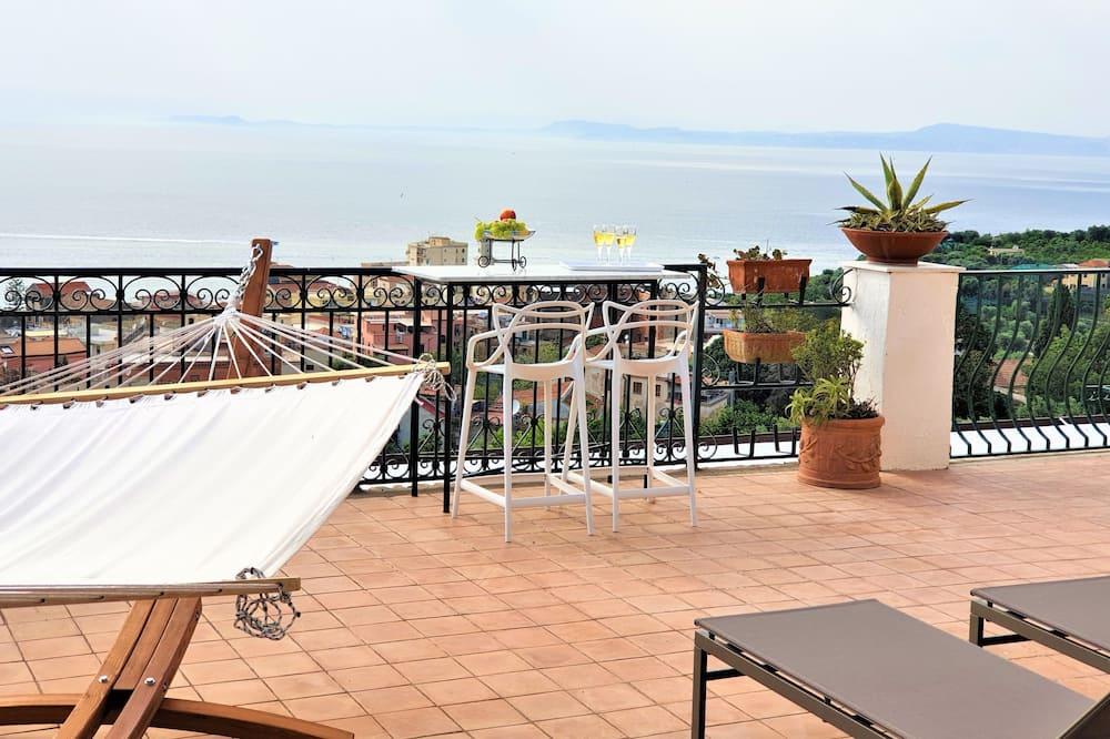 Suite Deluxe, vista al mar - Balcón