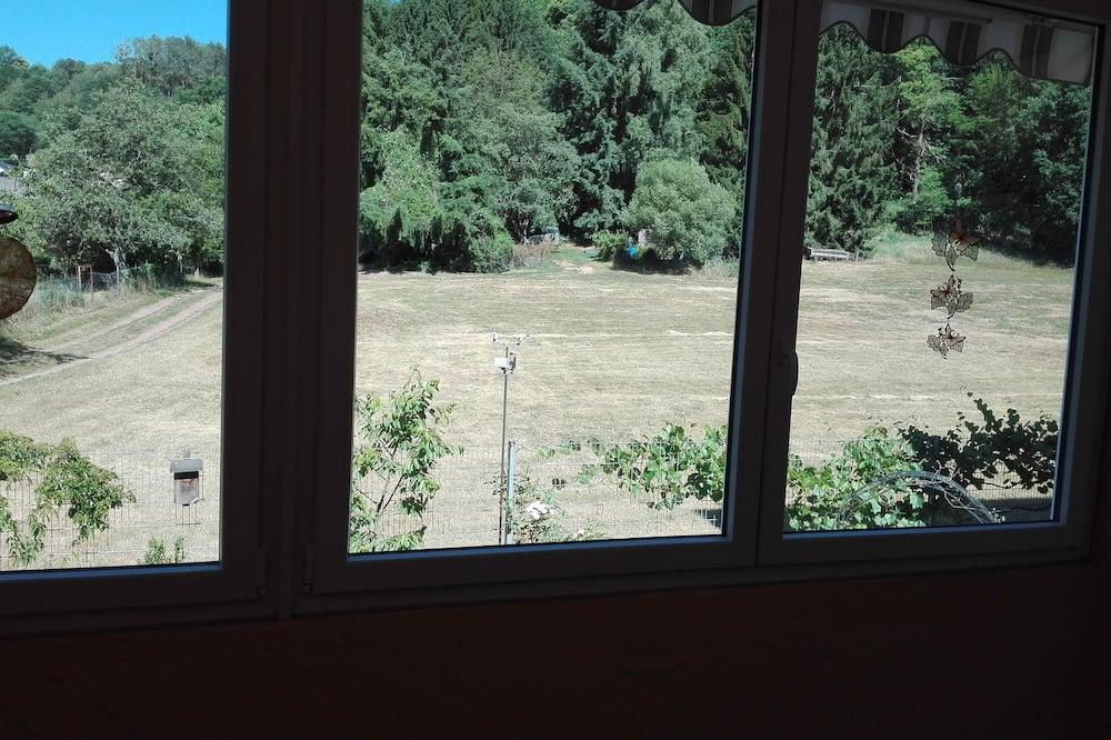 Appartement, op benedenverdieping - Uitzicht vanaf balkon