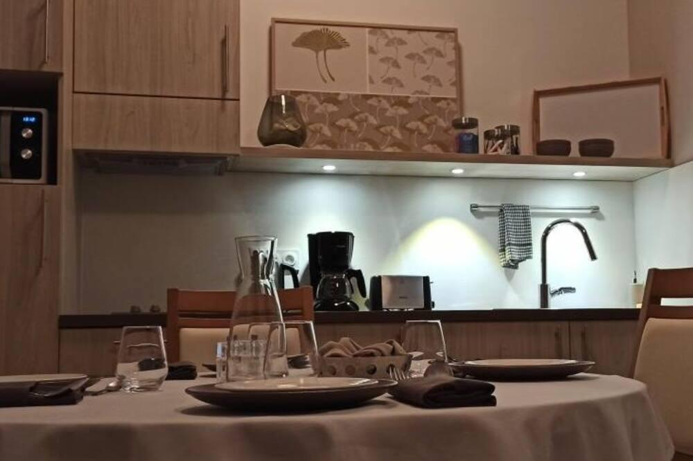 Ferienhaus (Appartement) - Essbereich im Zimmer