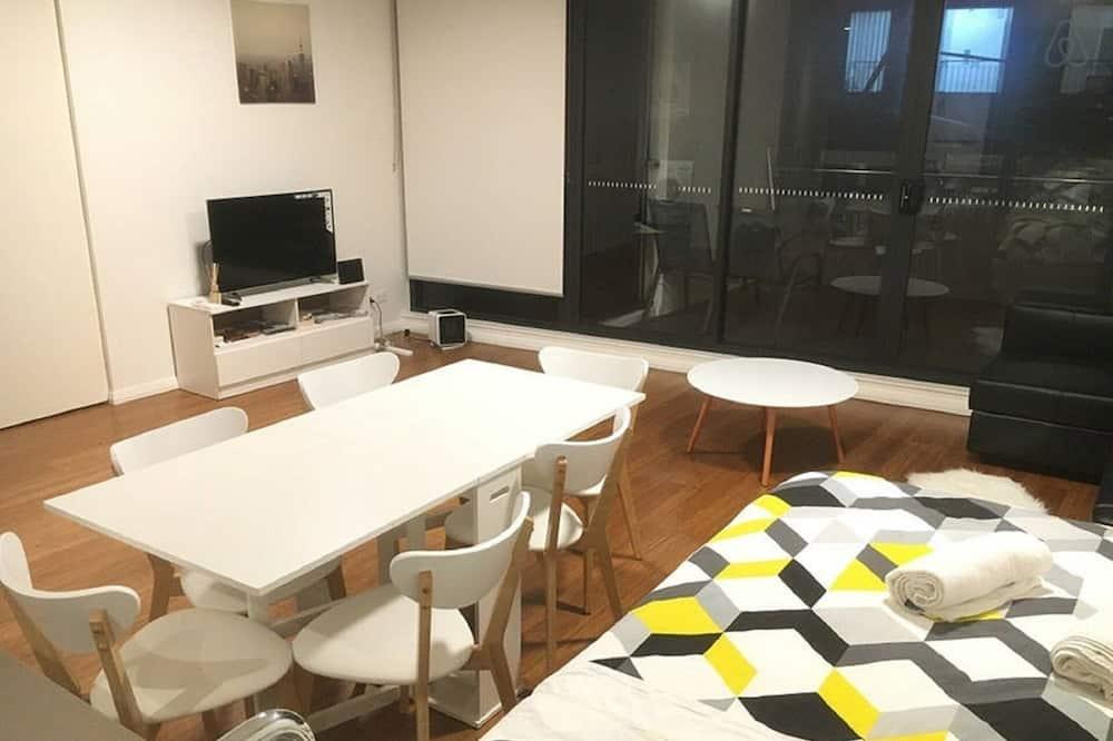 City-Apartment - Wohnzimmer