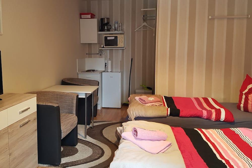 Camera Standard con letto matrimoniale o 2 letti singoli, angolo cottura - Area soggiorno
