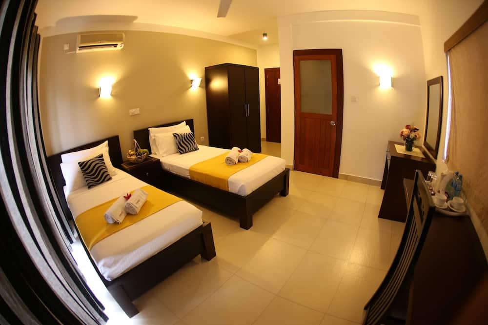 Liukso klasės dvivietis kambarys (2 viengulės lovos) - Svečių kambarys