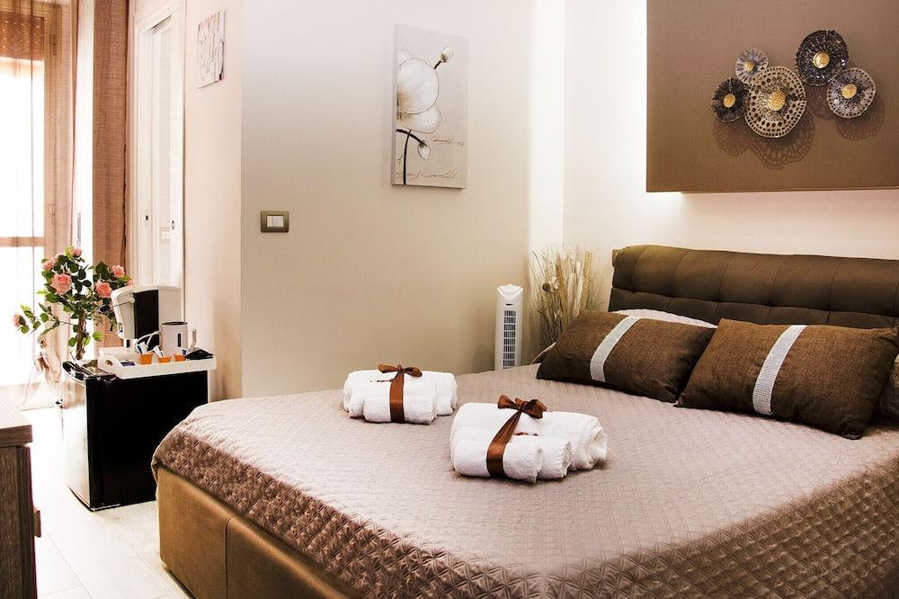 Pokój dwuosobowy typu Deluxe, balkon, widok na miasto (Kiss) - Powierzchnia mieszkalna