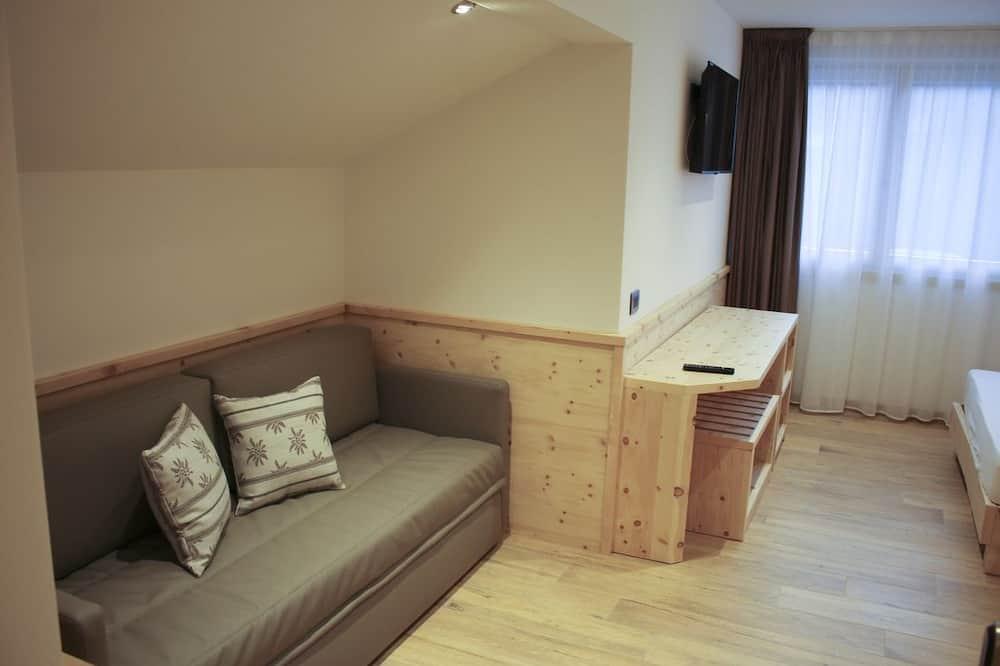 Třílůžkový pokoj typu Comfort (Tonalite) - Obývací prostor