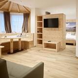 Čtyřlůžkový pokoj typu Comfort (Quarzo) - Obývací pokoj