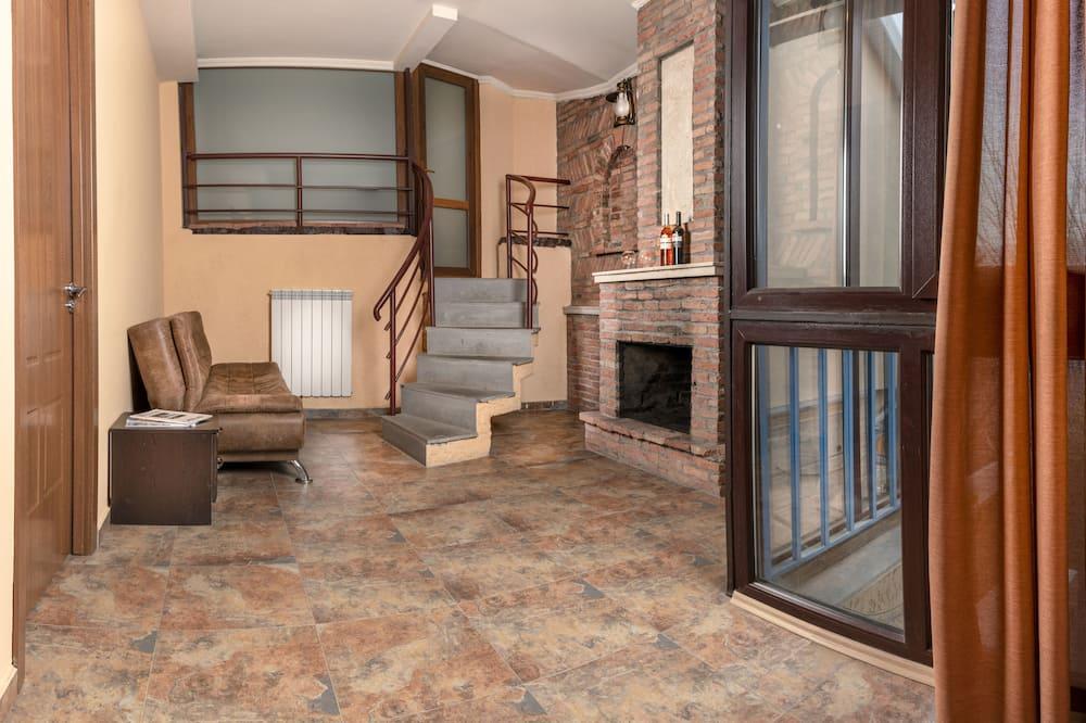Familienzimmer, Gartenblick - Wohnbereich