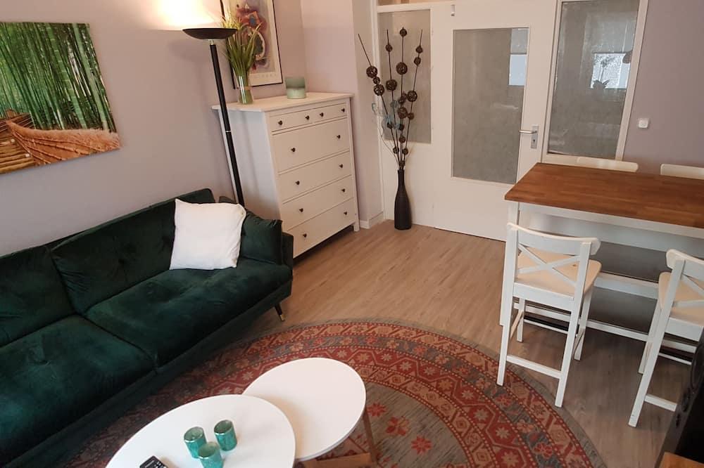 City-Apartment, 1 Schlafzimmer - Essbereich im Zimmer