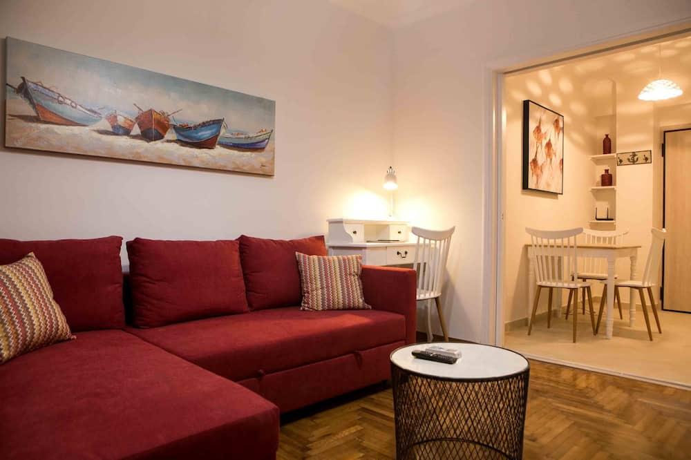 Apartamento urbano, 1 cama de casal com sofá-cama, Cozinha, Vista para a cidade - Imagem em destaque