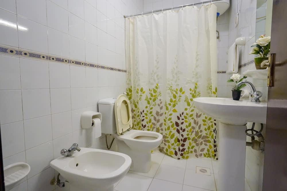Habitación básica, habitaciones comunicadas - Baño