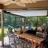 An eclectic beach themed, 3BR, 2 1/2 Bath with private pool and lanai .
