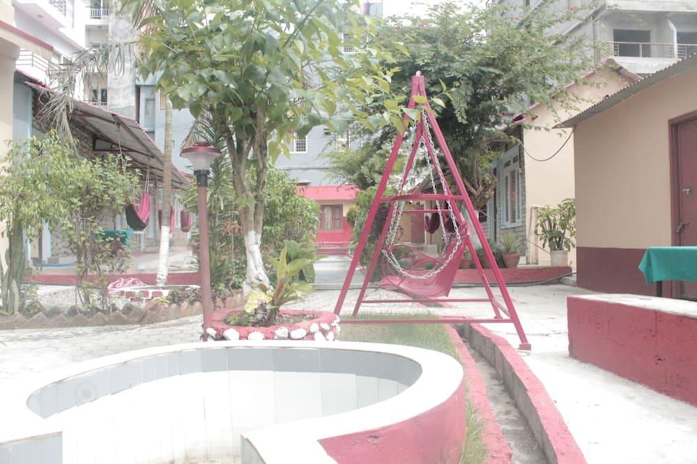 Deluxe-Dreibettzimmer - Blick auf den Garten