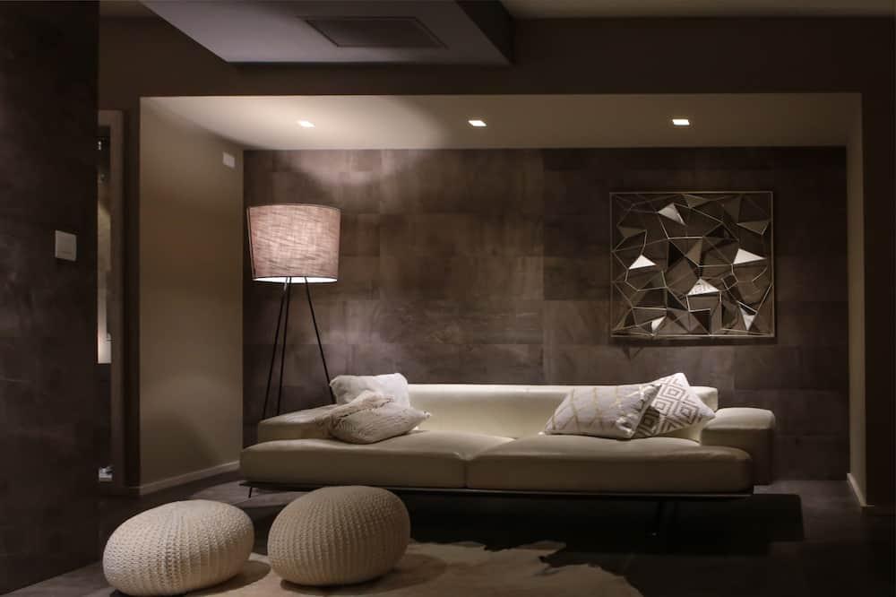 Suite Deluxe, 1 letto queen - Area soggiorno