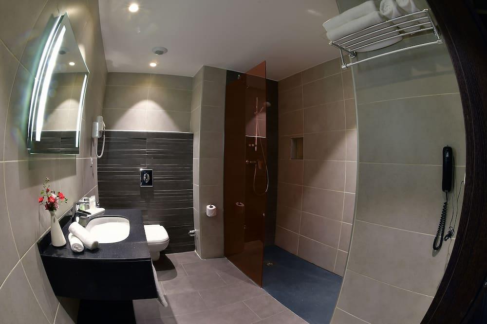 Verslo klasės numeris - Vonios kambarys
