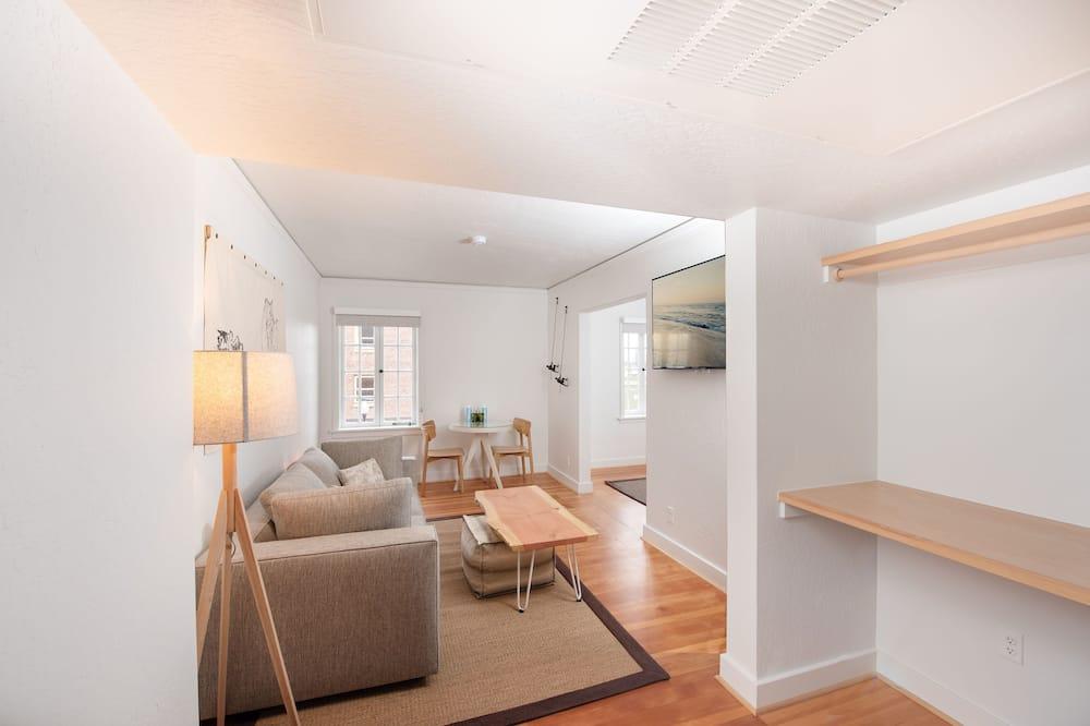 Suite, 1 letto king con divano letto - Area soggiorno