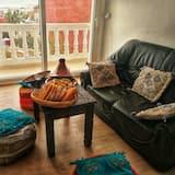 مكان نوم مشترك واسع - بمطبخ - منطقة المعيشة