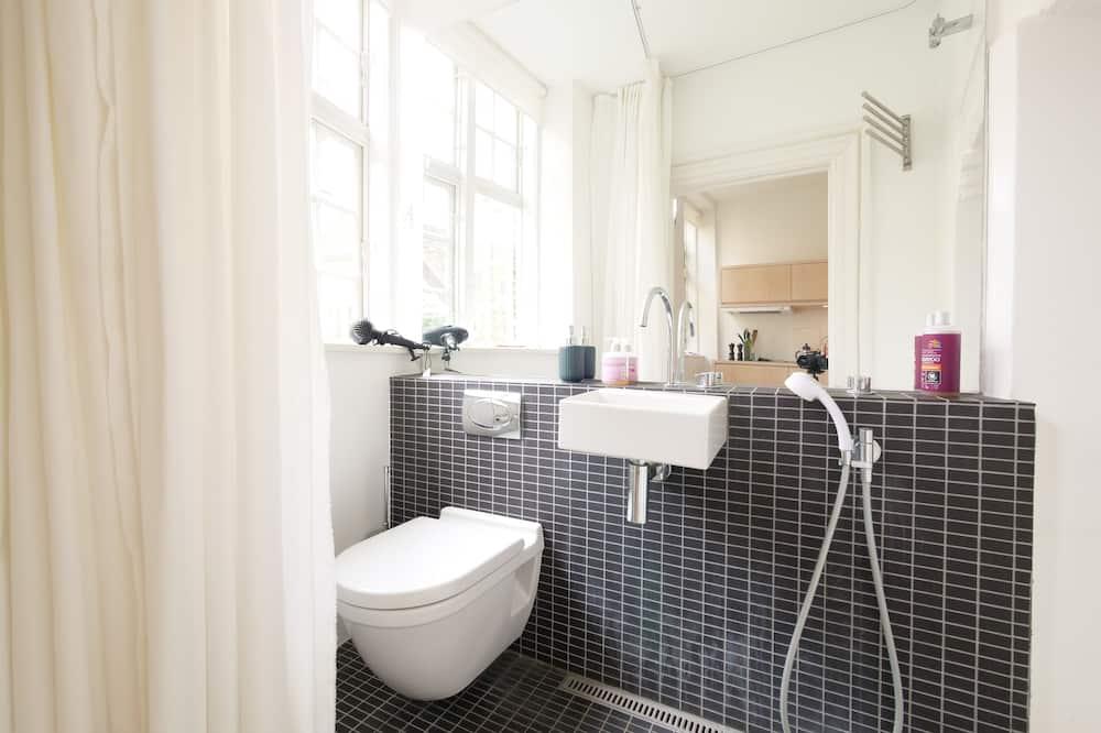 City-Apartment - Badezimmer