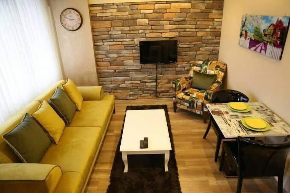 Studio Suite tiện nghi đơn giản - Khu phòng khách