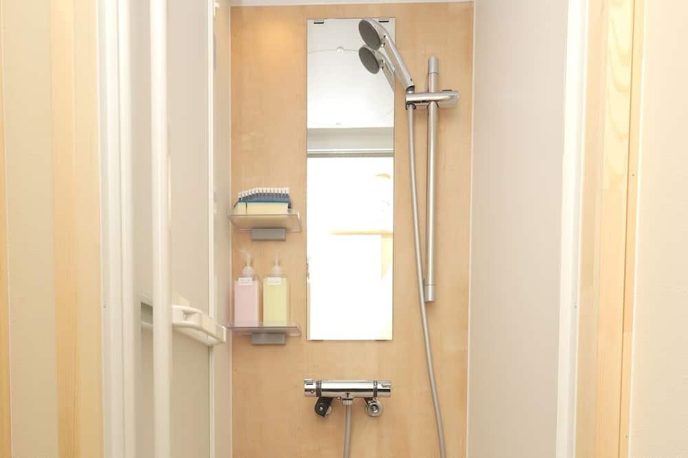 ROOM 1 JR Mobile Inn - バスルームのシャワー