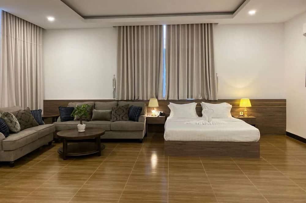 Premium Quadruple Room - Living Room