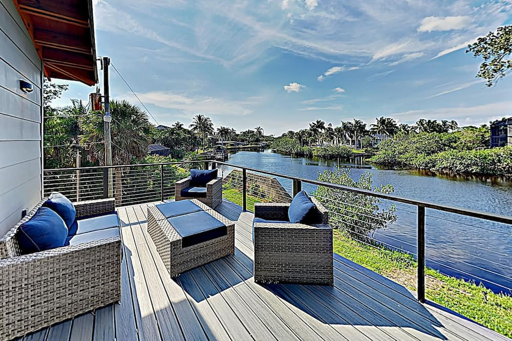 New Listing! Riverfront W/ Hot Tub & Dock 3 Bedroom Home