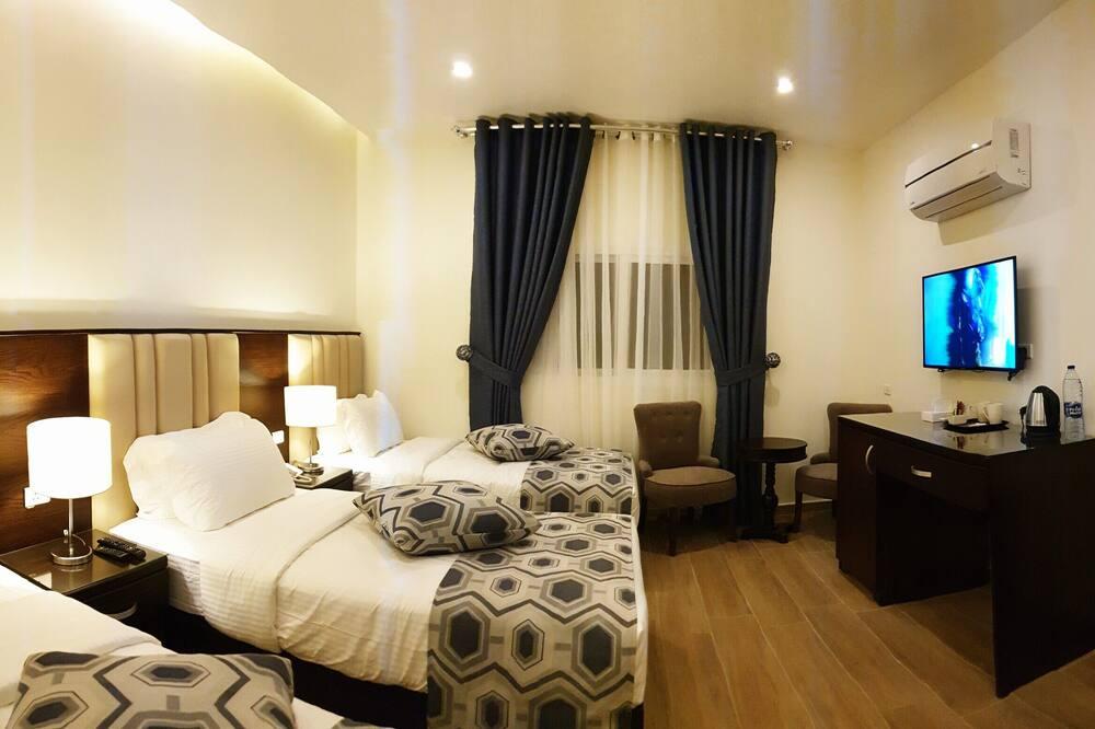 Habitación triple Deluxe - Habitación