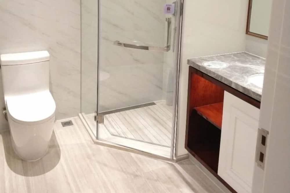 シグネチャー ルーム キングベッド 1 台 - バスルーム