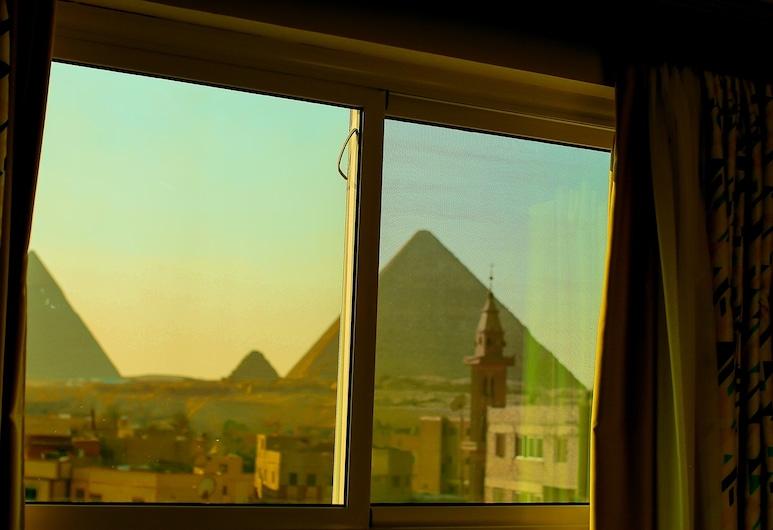 Pyramid edge, Giza, Vista para a cidade