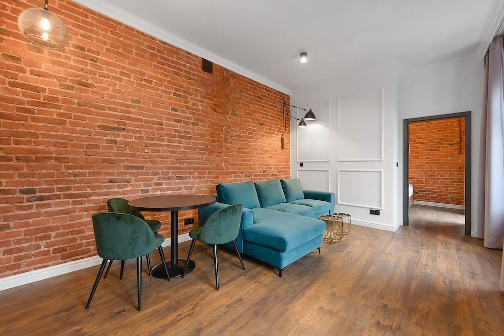 Deluxe-Apartment, Balkon (1) - Wohnzimmer