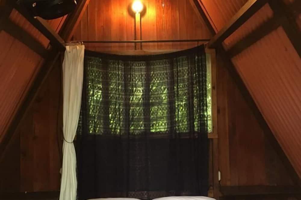 Pamatklases divvietīgs numurs, viena guļamistaba, privāta vannasistaba, skats uz dārzu - Numurs