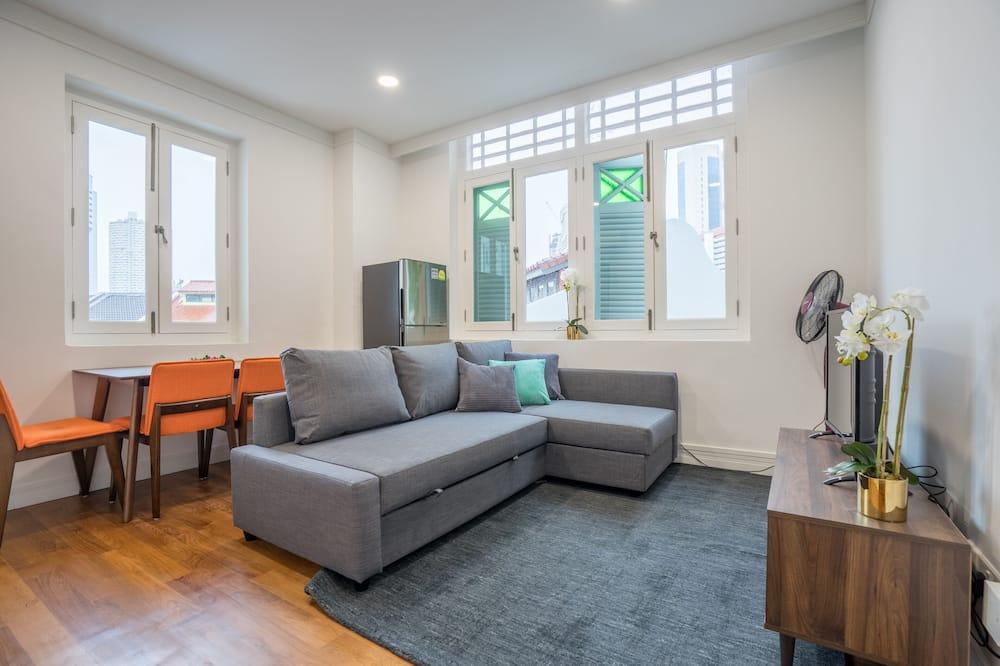 Апартаменты «Делюкс» (203) - Зона гостиной