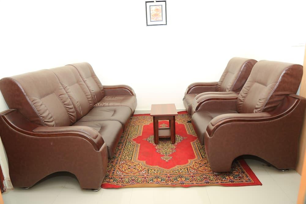 Kambarys verslo klientams (1 dvigulė / 2 viengulės lovos) - Svetainės zona