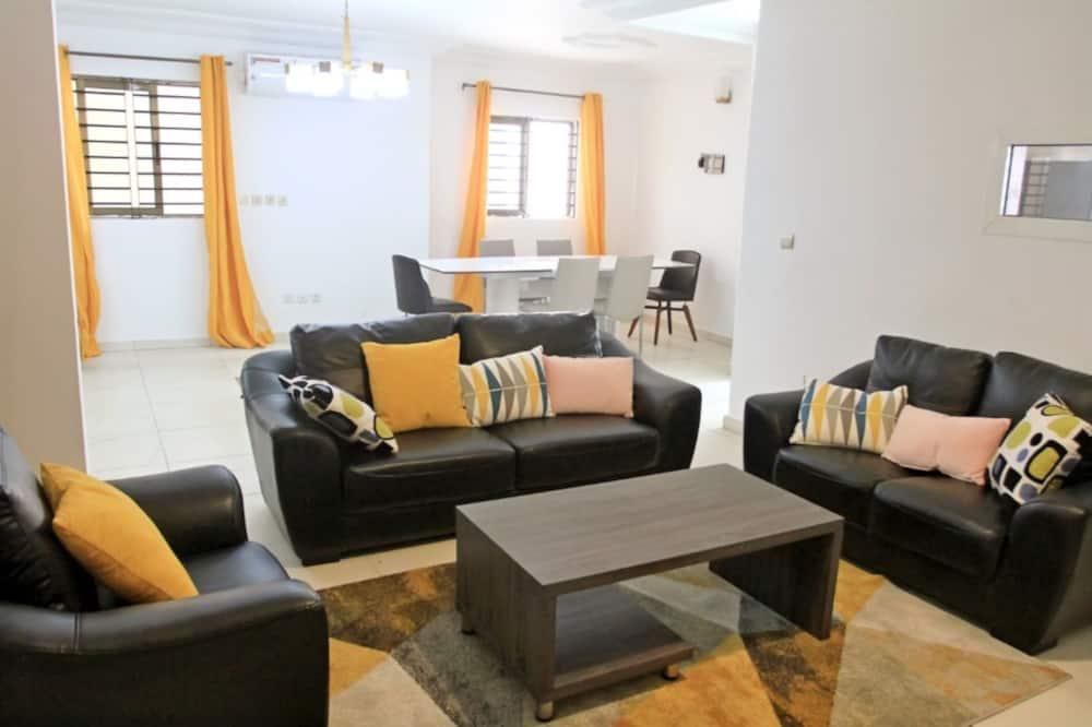 Rodinné dvoupodlažní apartmá - Obývací pokoj