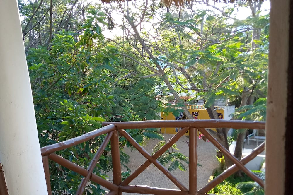 Kambarys šeimai - Vaizdas į sodą